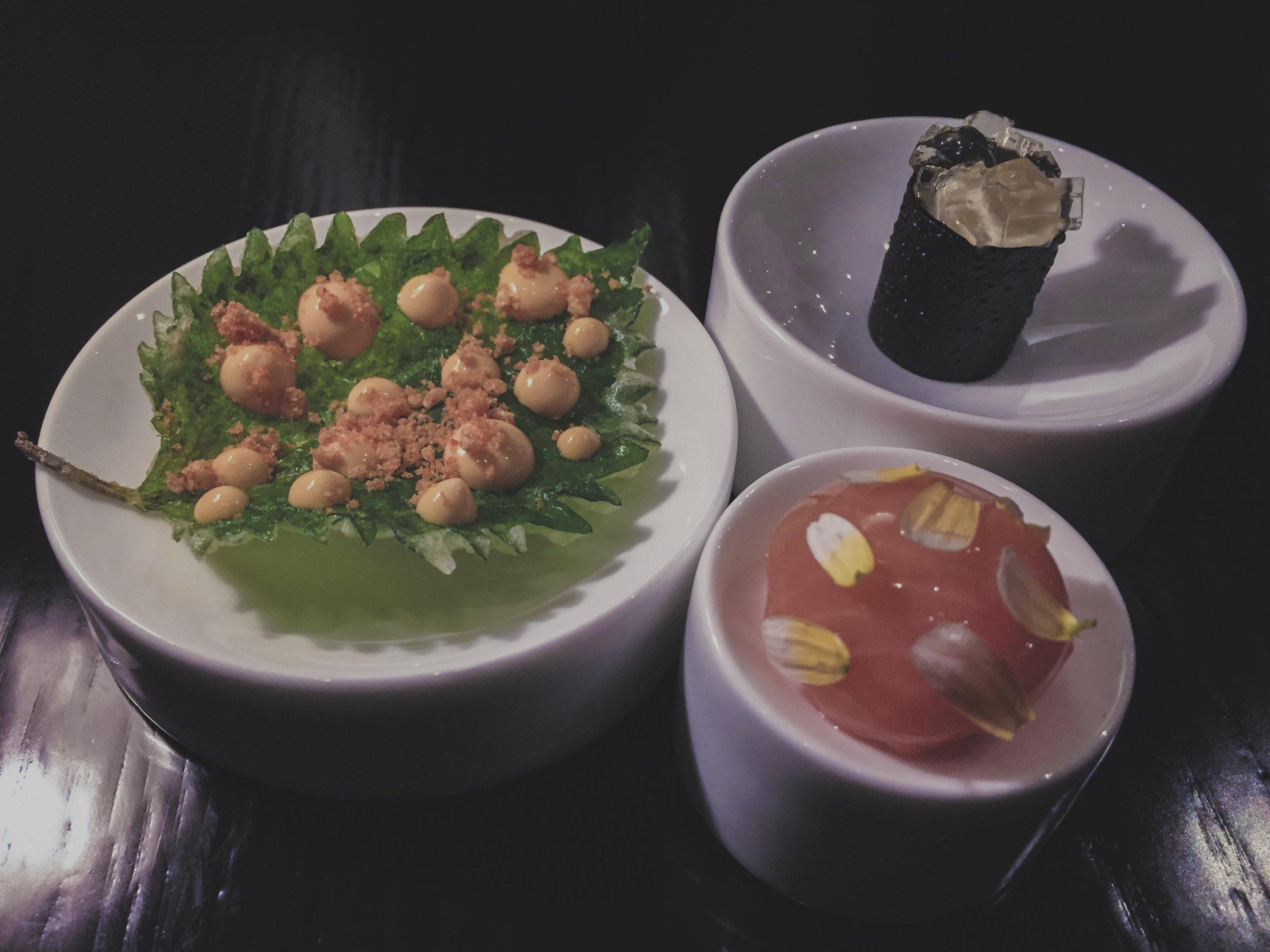 Clockwise from the top: Hiramasa kingfish, dashi cream, water chestnut, nori, dashi jelly.                                                                        Saikou salmon, smoked roe, sudachi, chrysanthemum.                                                                                                   Tempura oba, smoked amaebi, shell powder.