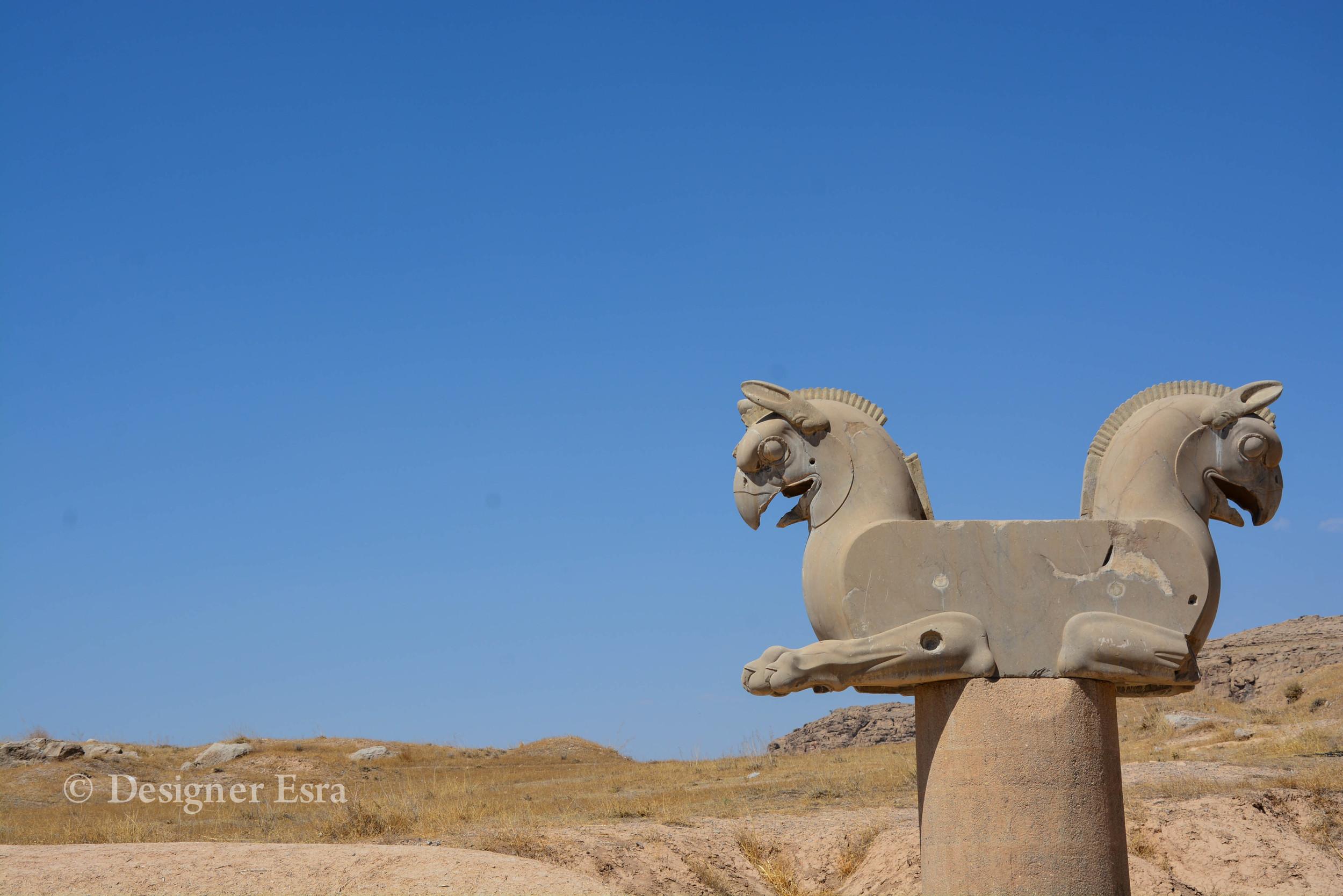 هما Homa, is a mythical bird of Iranian legends (Griffin-like)