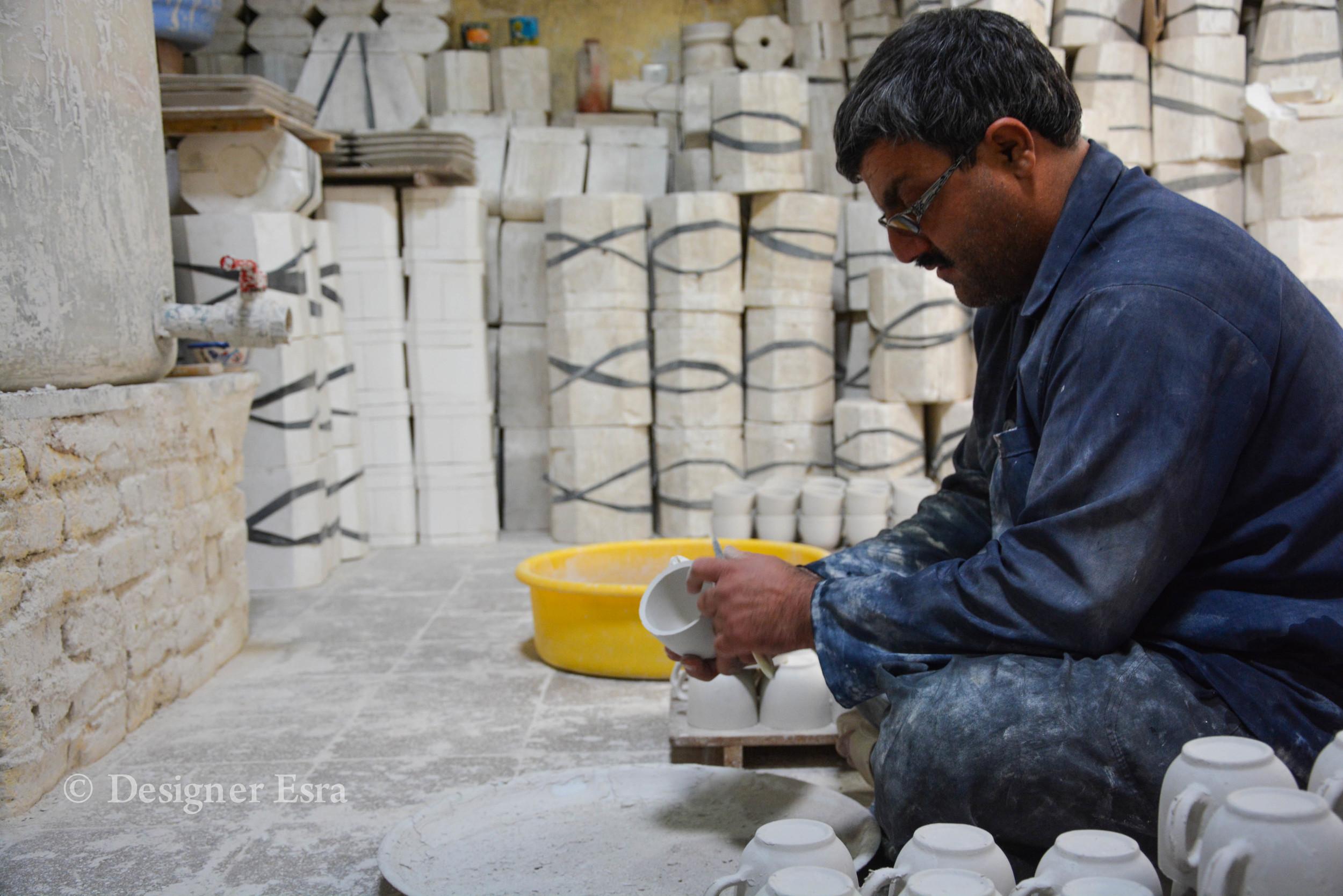 Sanding pottery in Iran