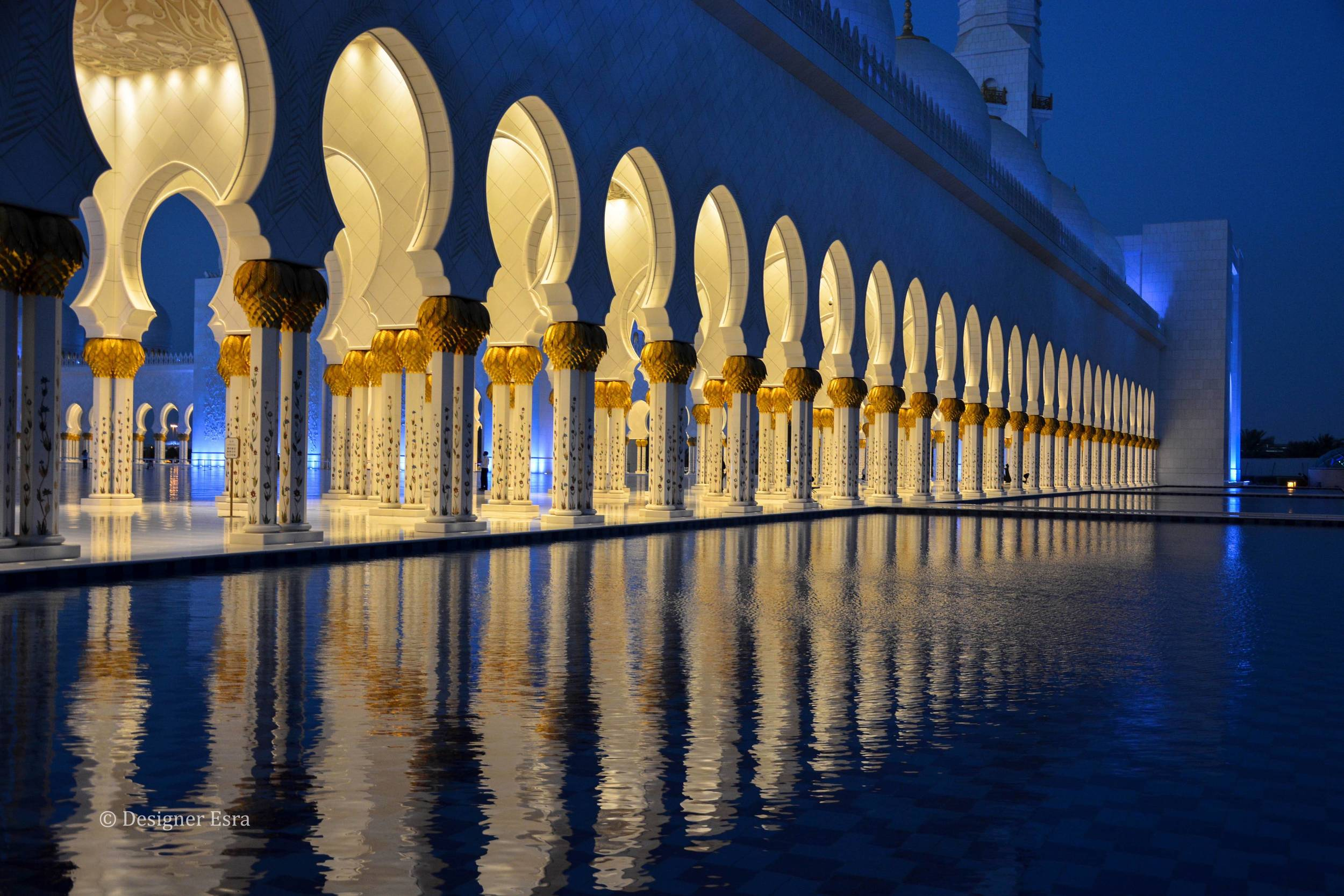 Sheikh Zayed Grand Mosque's columns reflected in the water
