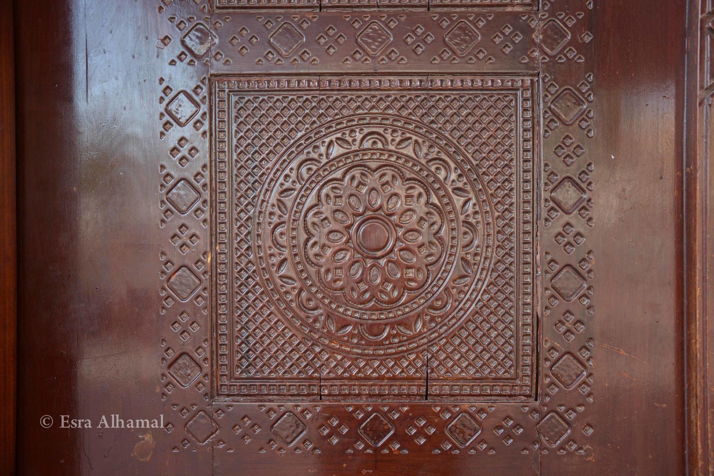 Wooden door details in Madina