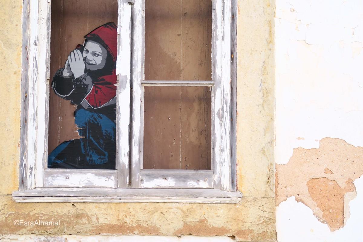 Graffiti in windows Lagos, Portugal