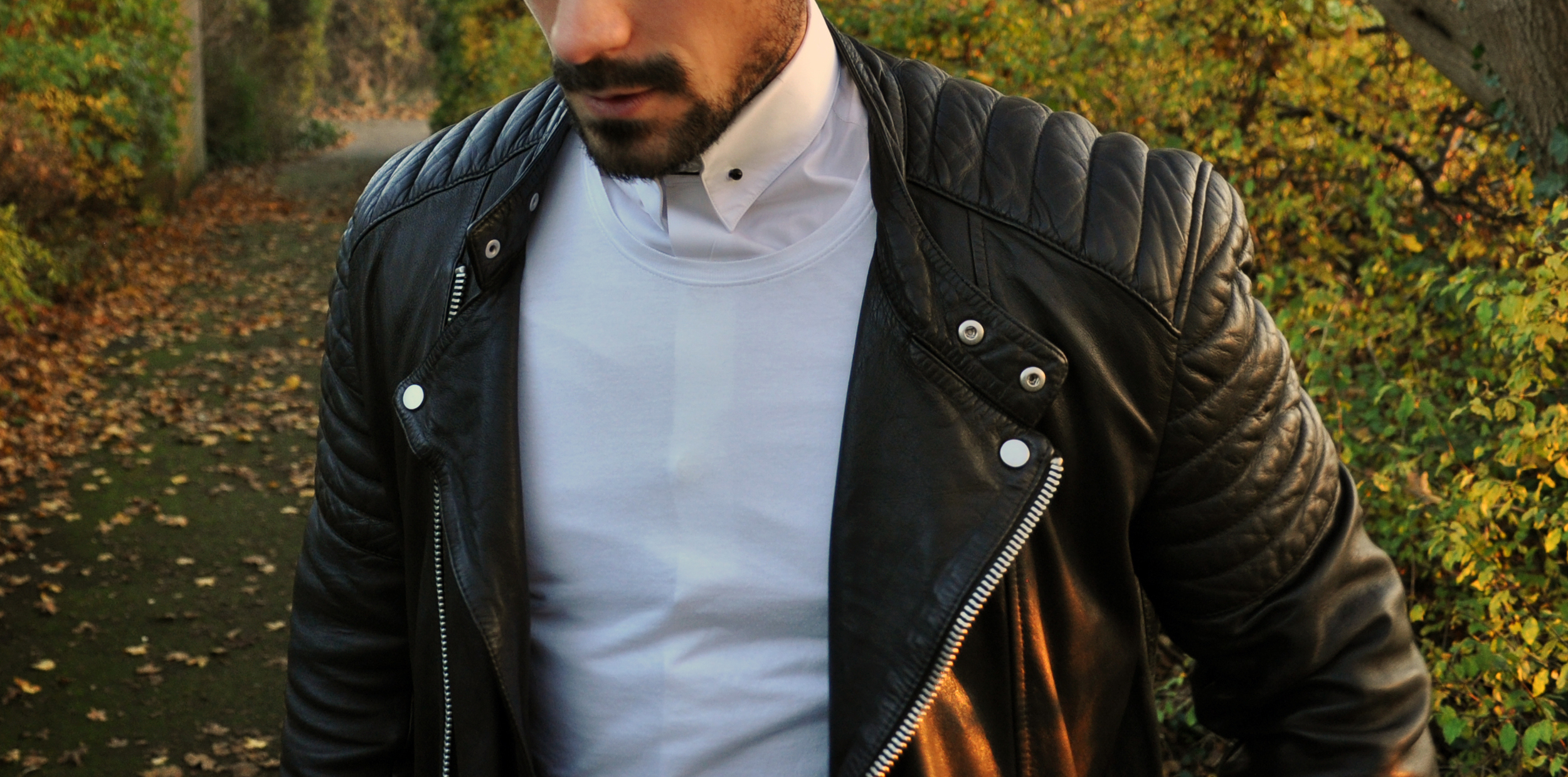 A simple plain white t-shirt over the top of the   White Pin Collar Shirt   transforms this look whilst adding a touch of layering. Keeping to the monochrome theme, I used a   Black Swarovski Collar Bar  .