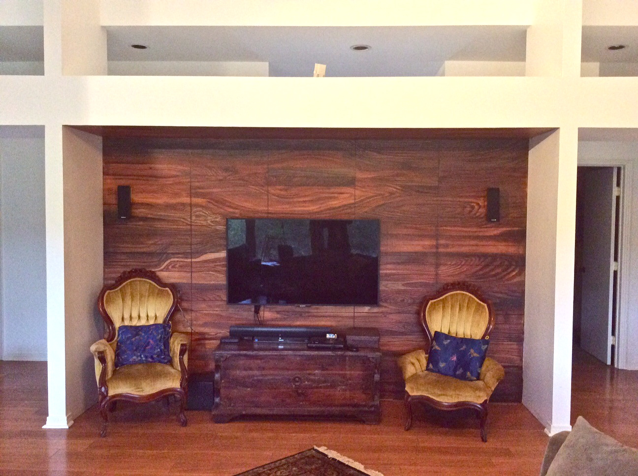 Texas Hill Country Residence.  7'x14'.  Inspired by the beauty of woodgrain Kara uses the tromple-l'oeil method to mimic an american black walnut wall.