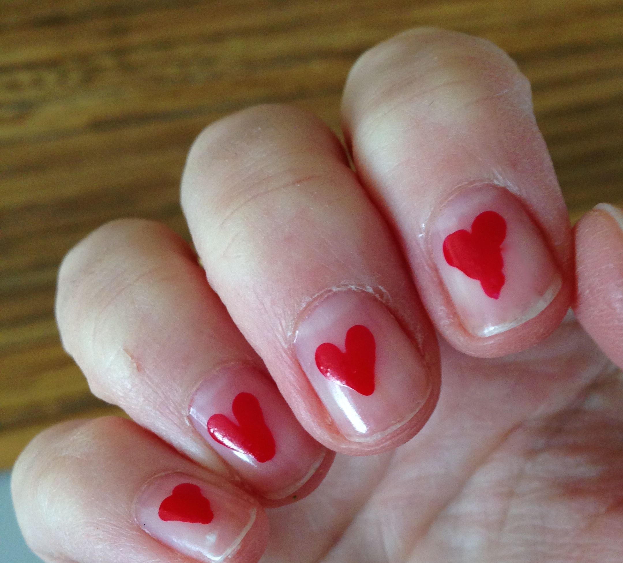 This is where you ignore my cuticles and go give this flirty little DIY a try.  And no, I didn't let Xavier have a go on my index finger, that's my very own Van Gogh version of a heart.