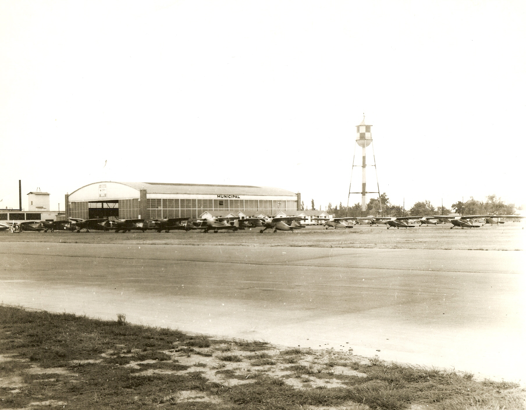 hanger 1 with airplanes on grass.jpg