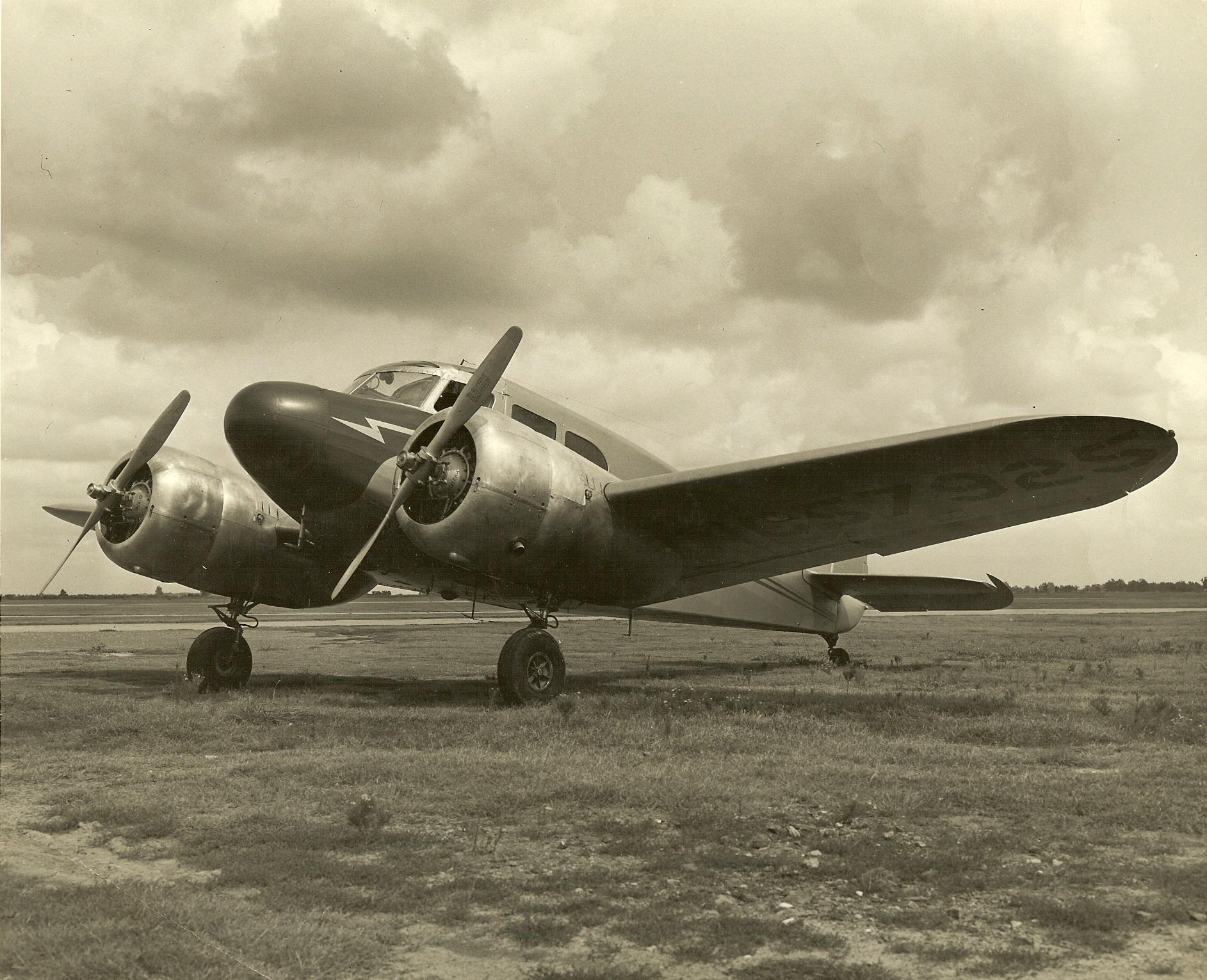 old prop plane in grass.jpg