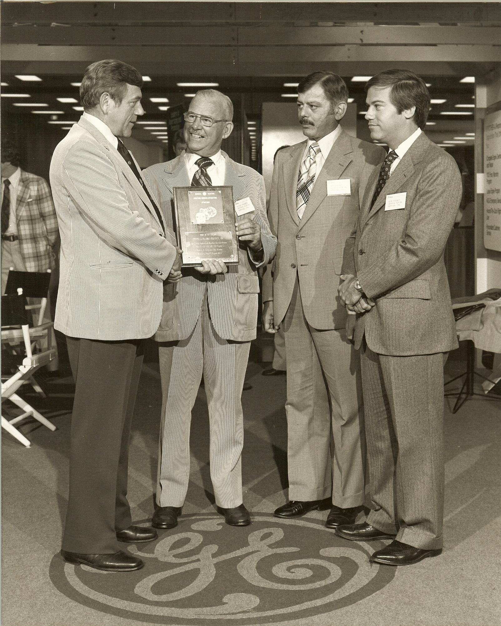 C. Holbert, R. Holbert, D holbert GE award late 1970s.jpg