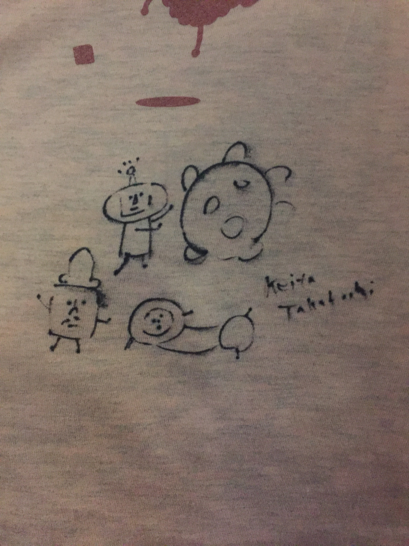 Keita made pretty pictures on people's shirts, badges, programs..