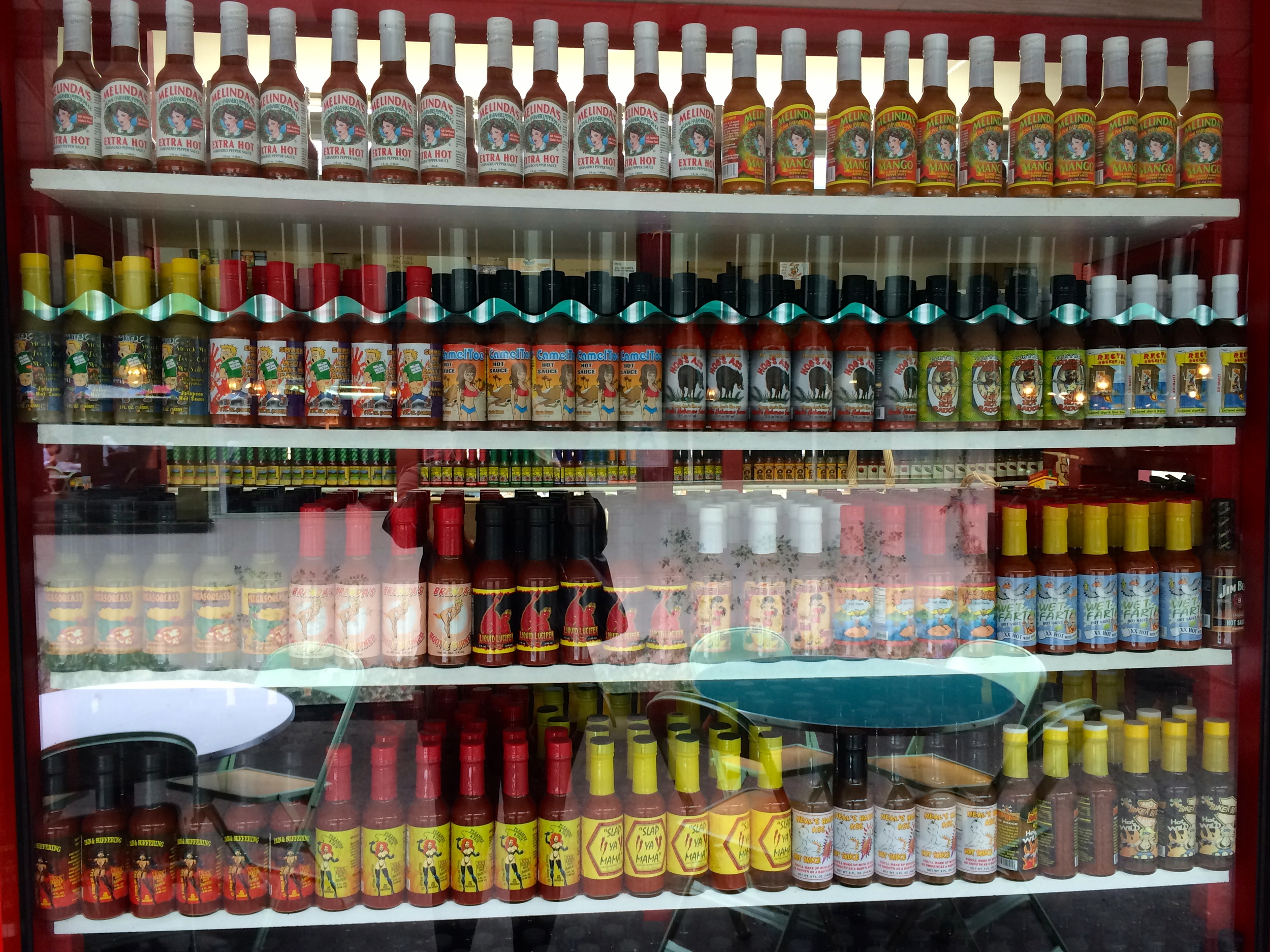 A wall of hot sauces from Light My Fire in the market.