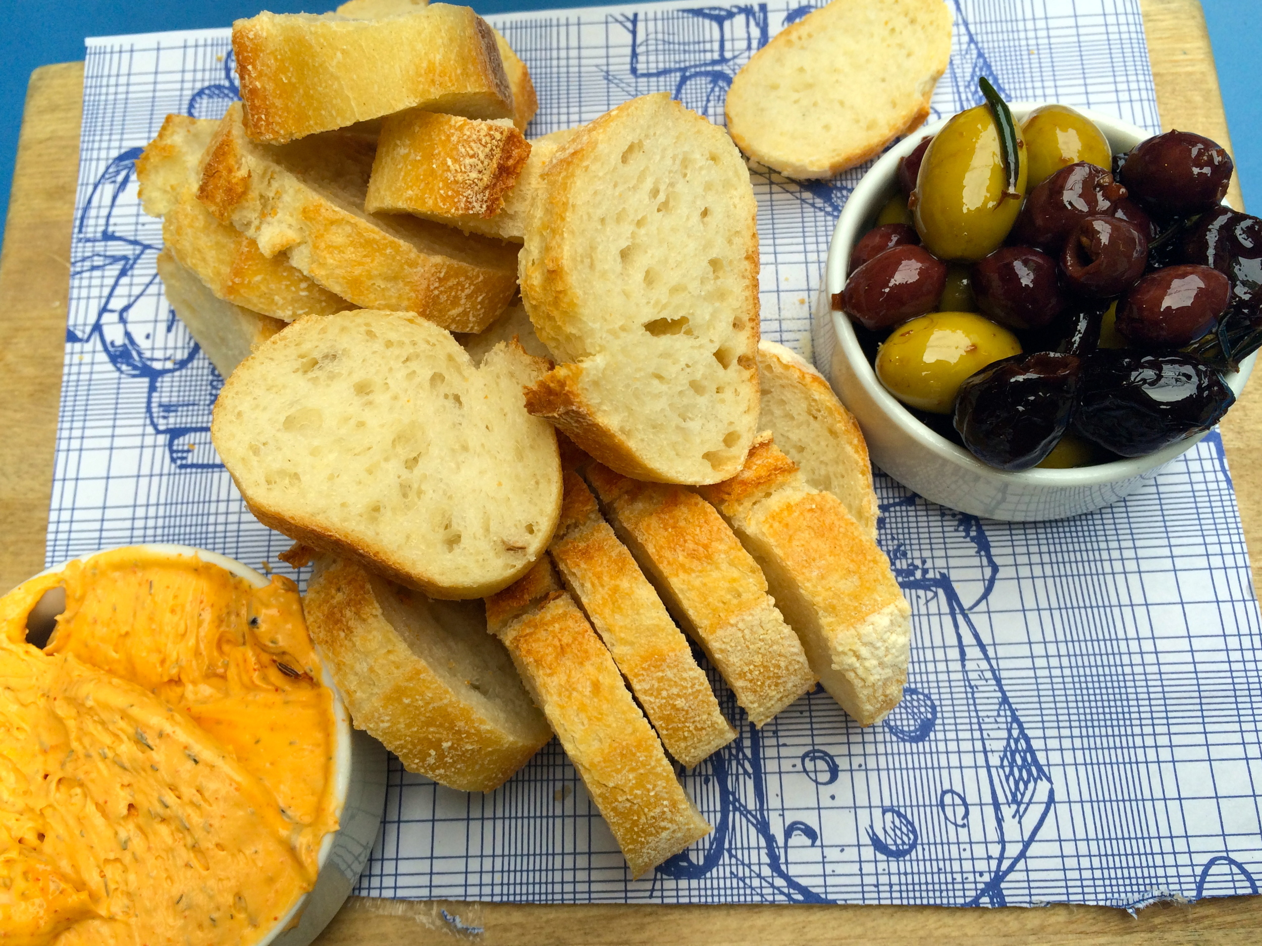 Olives, baguette and caviar cheese, a specialty at Mr. Marcel Gourmet Market.