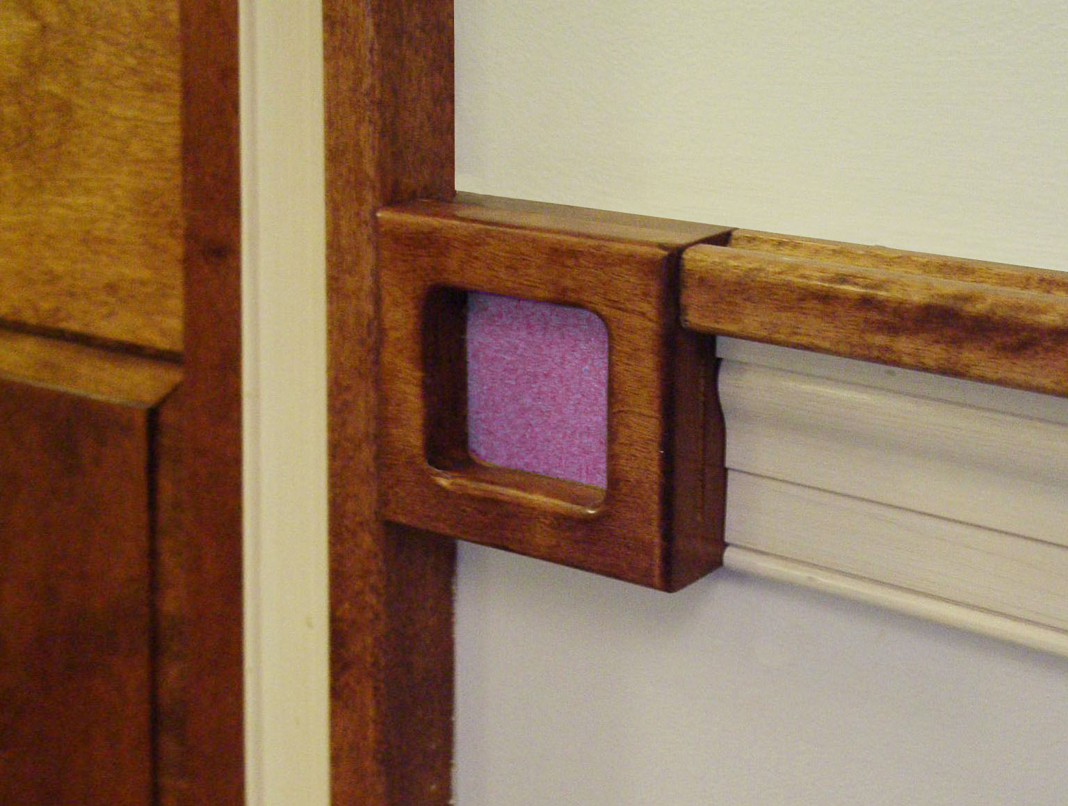 Inserts next to each bedroom door have uniquely different colors and textures so that the most severely impaired students can still identify their room.