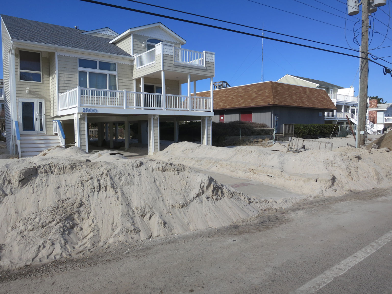 Sand had to be shoveled out of many homes.