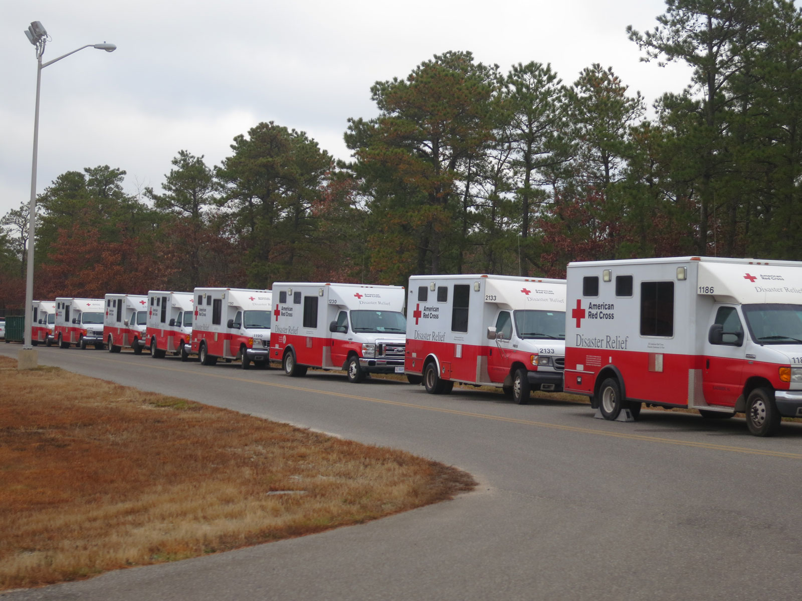 Early on Thanksgiving morning, some of the 43 ERVs lined up to receive their day's supply of hot food at K-3.  Some trucks go to shelters, some to street corners, and others make set rounds. Other ERVs left from two other kitchen locations to serve the entire State.