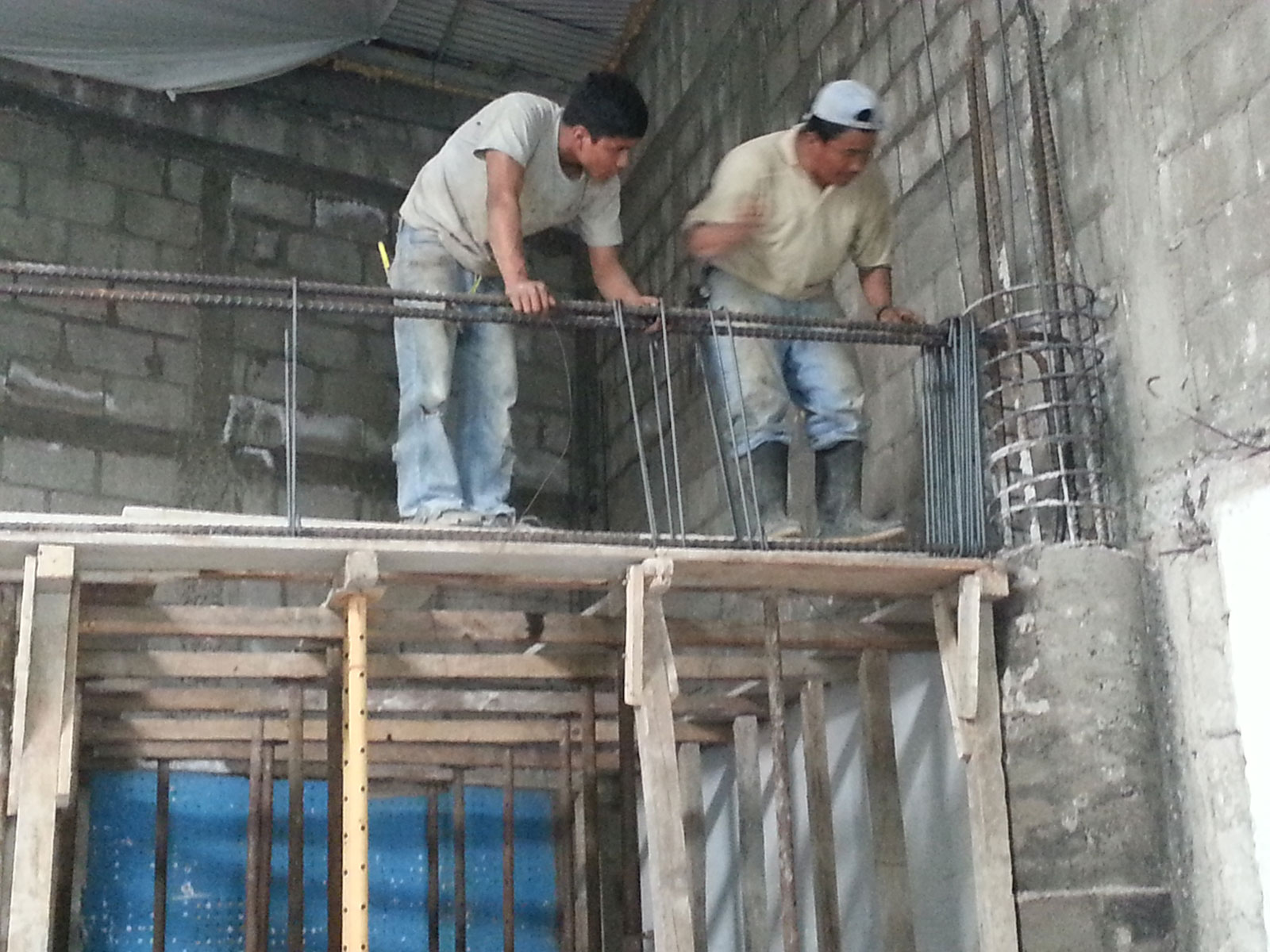 Workers at the Genesaret Church in Guatemala City begin reinforcement of the two story walls to accommodate a second floor.  A combination of rebar, poured concrete and block walls  provides earthquake protection and added security against intrusion.