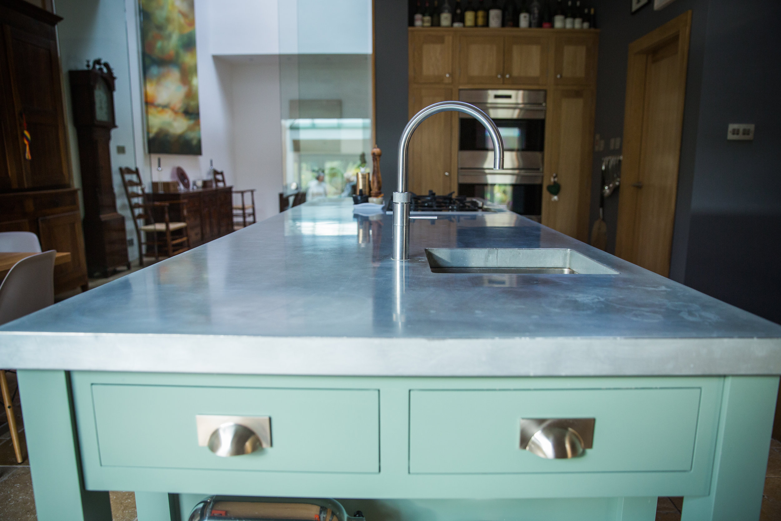 Court Lodge island unit - painted cabinetry with zinc worktop.