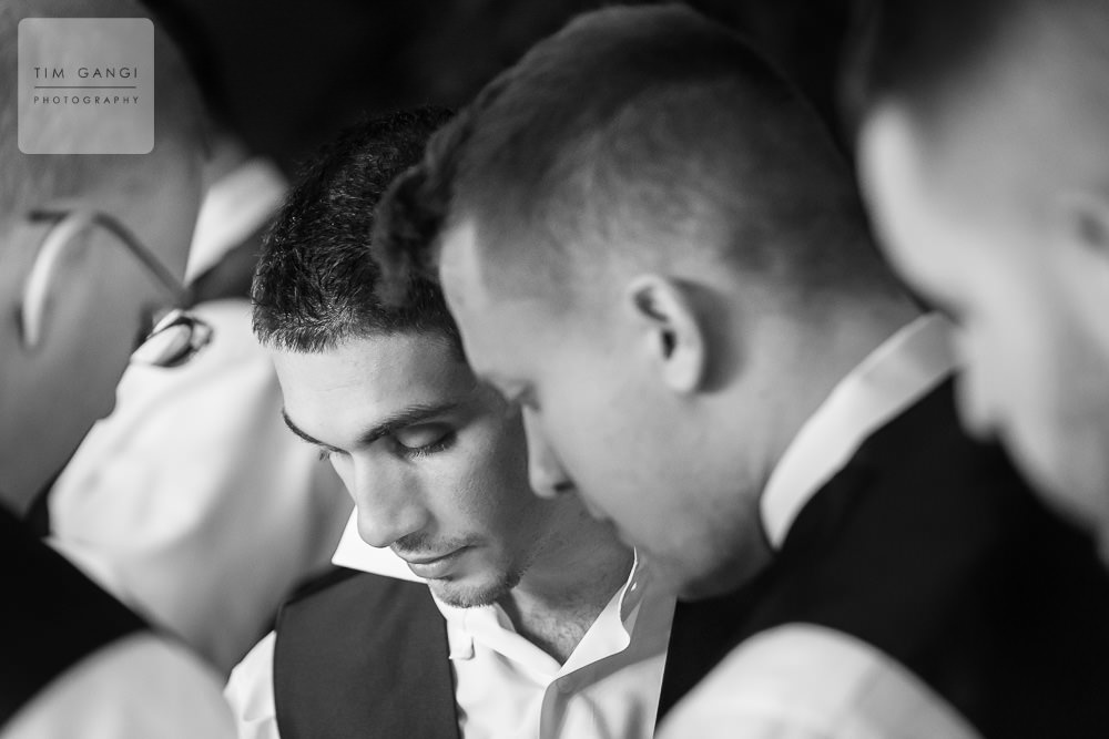 Elias getting some help with his details from the Groomsmen.
