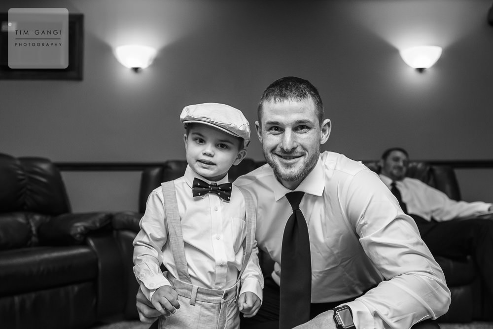 The ring bearer and groom getting ready for the big day!