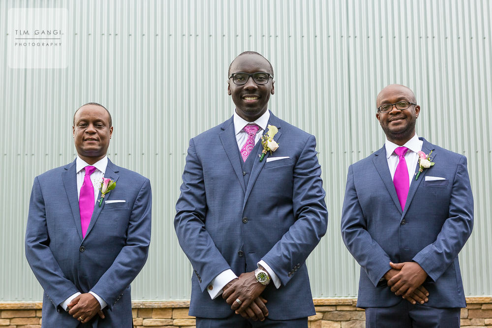 A couple happy groomsmen looking sharp as ever.