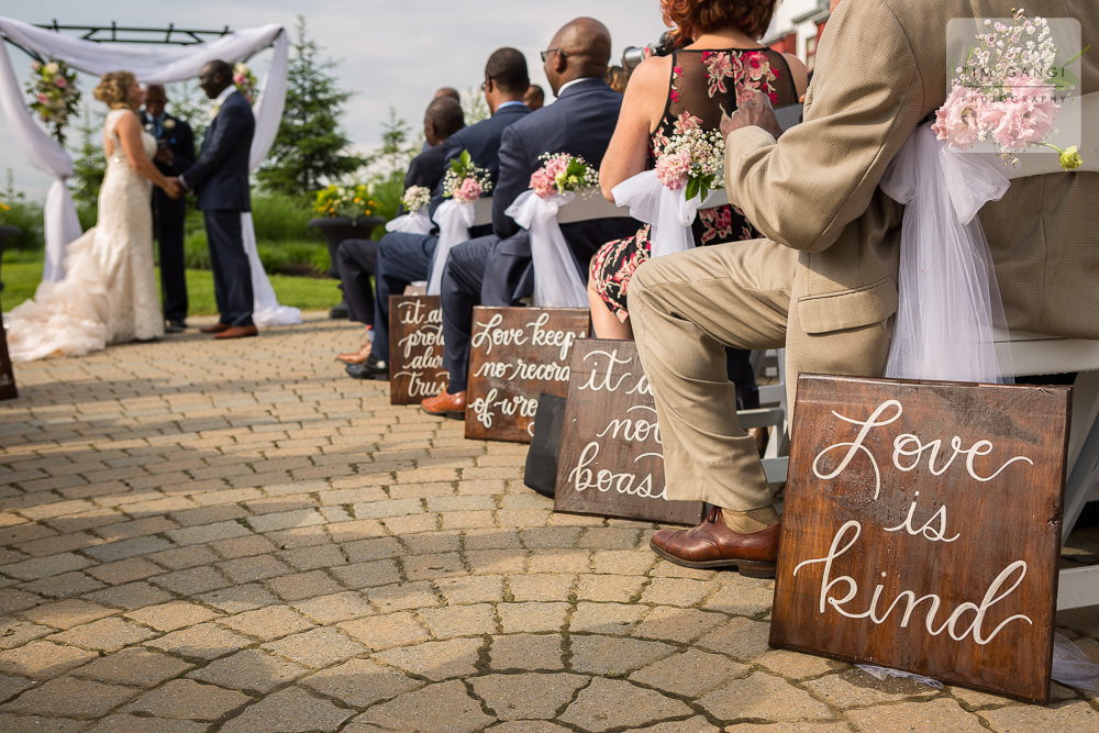 Inspiring wedding signs display words of wisdom on this perfect wedding day.