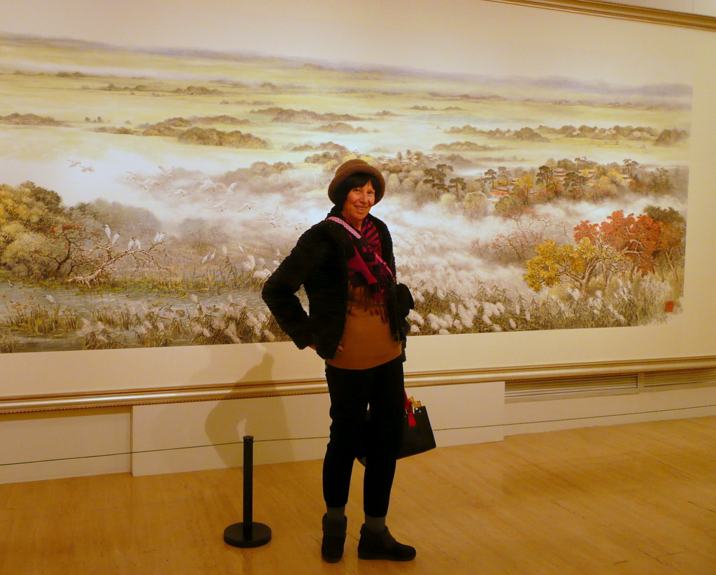 Chery in front of monumental autumn scene huahua
