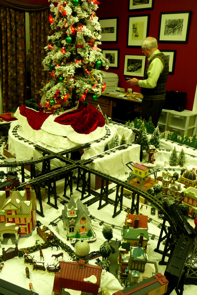 Mike Wright and train layout with Christmas tree
