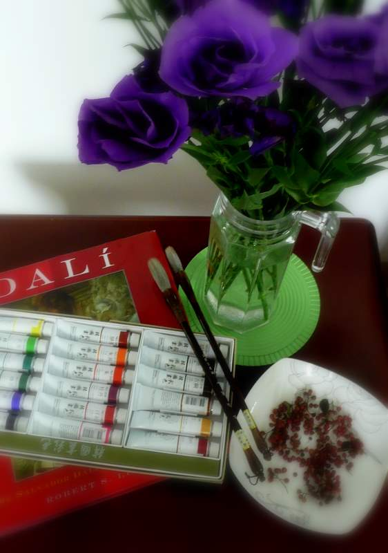 Still life with lisianthus and paints