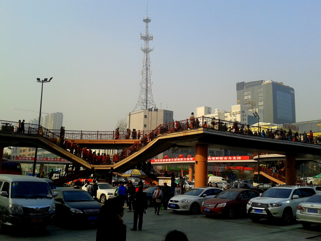 Elevated 8-way pedestrian causeway.  This is how you move a million people across the busiest intersection in town