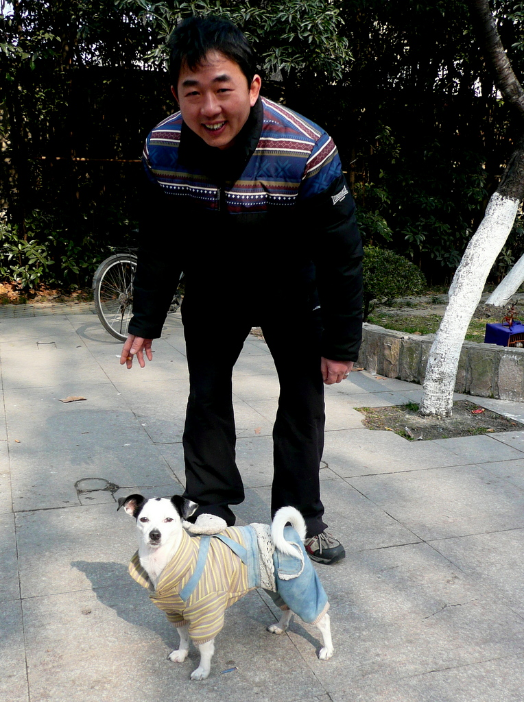 Man in park with dog
