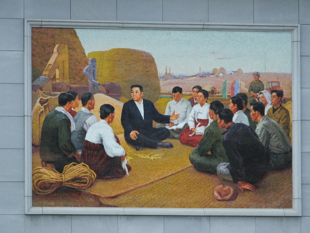 PRESIDENT KIM IL SUNG SITTING with the FARMERS
