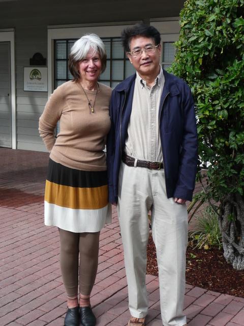 Sha Li and Qiu Xiaolong pose for selfies at Starbucks in Palo Alto, California.