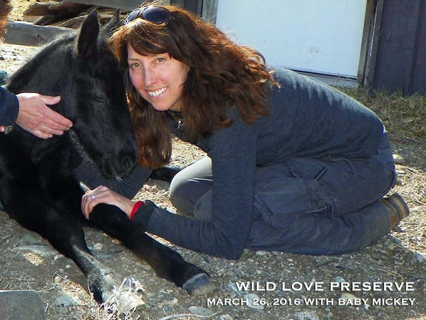 Wild Love Preserve founder and president, Andrea Maki, with our 5 day old baby Mickey.