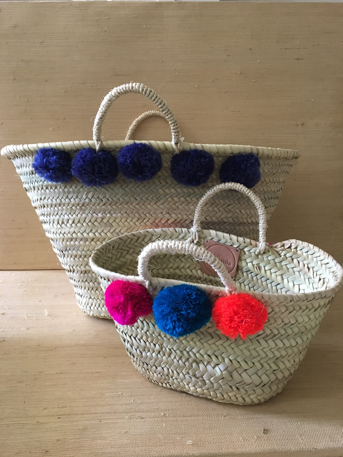 Bohemia's pompon basket. Available in two sizes with an array of colors.