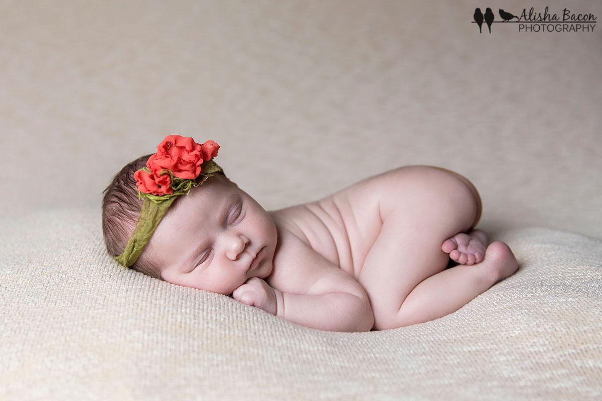 Newborn in poppy tieback