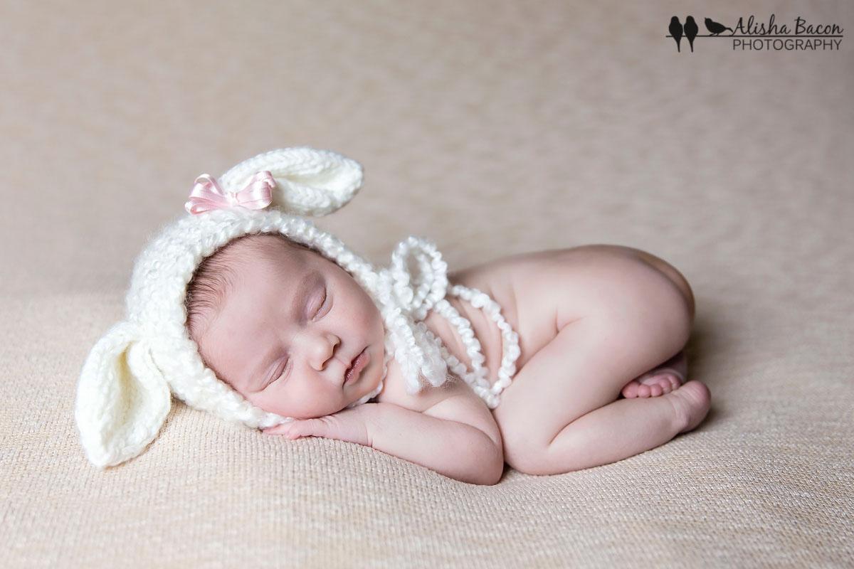 Newborn in lamb bonnet