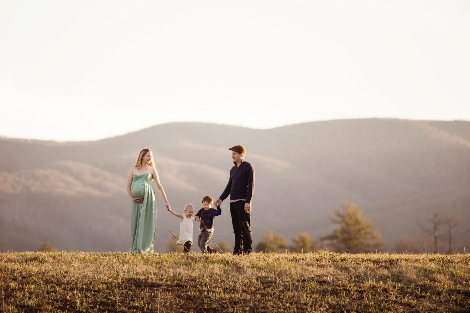 Family poses in Cades Cove for family pictures.