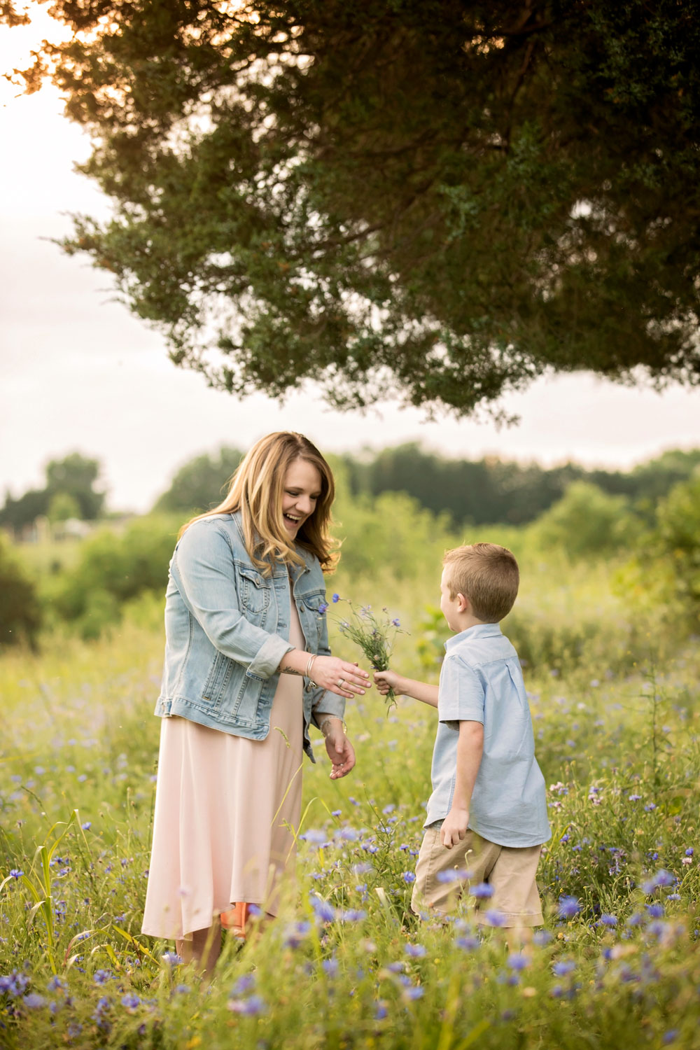 Little boy give Mom wildflower bouquet during Knoxville family photogtaphy session.