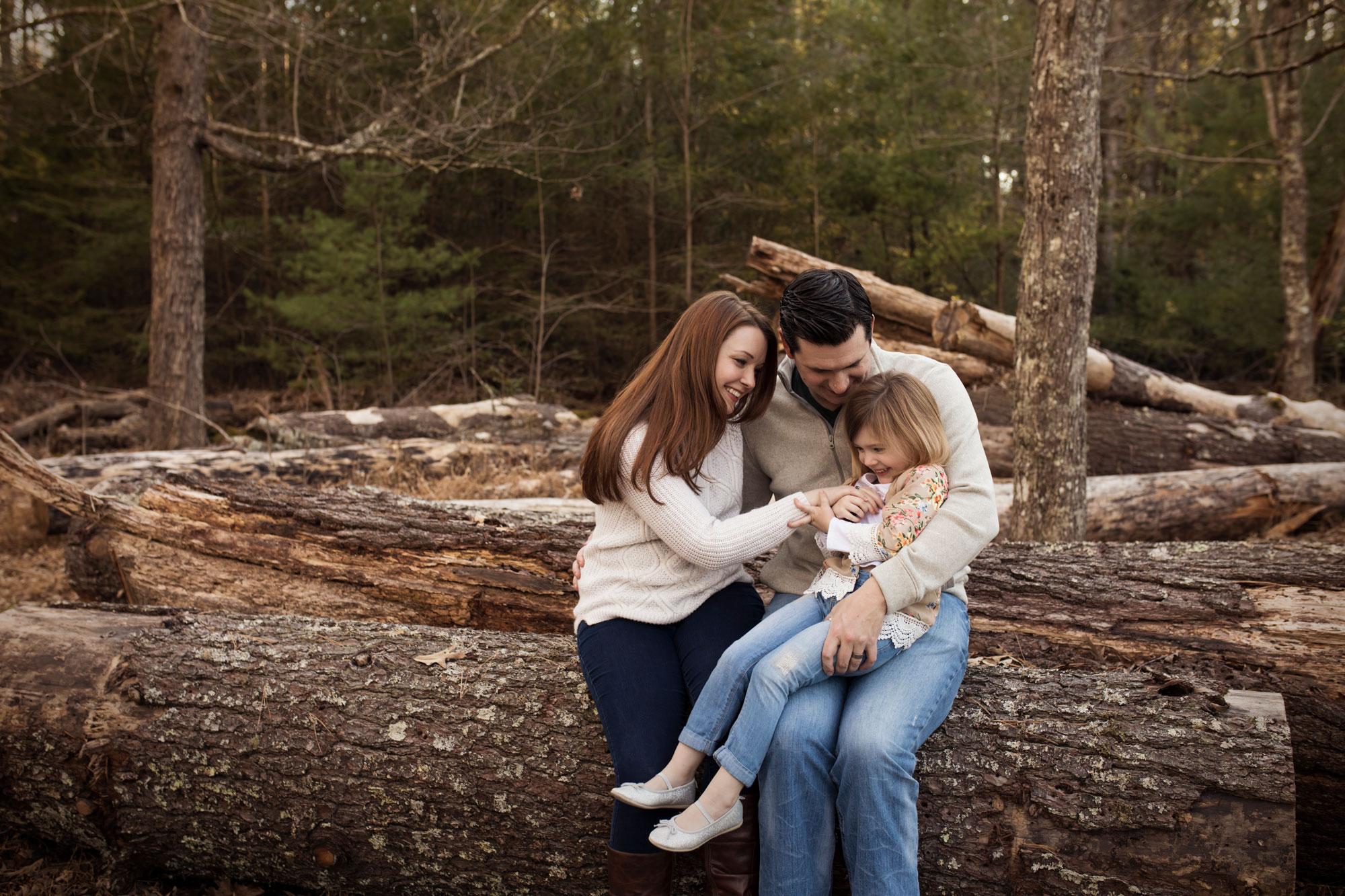 family-playing-on-log-gatlinburg-photographers.jpg