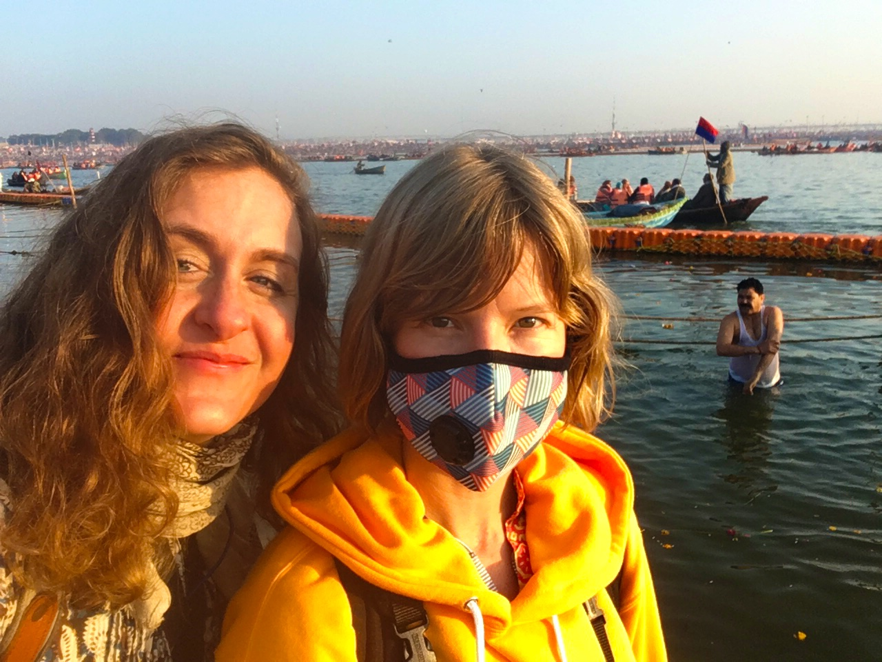 Sunrise on the Ganga in the Kumbha Mela, still wearing my mask to keep out the smoke