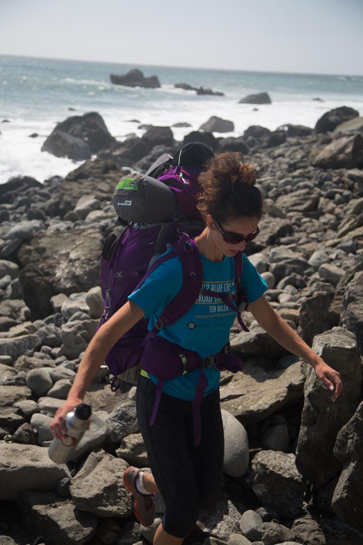 Picking her way through the rocks.