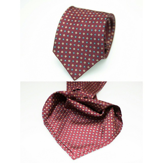 Our red MTO tie offering, using traditional tie-making methods:  the seven-fold.