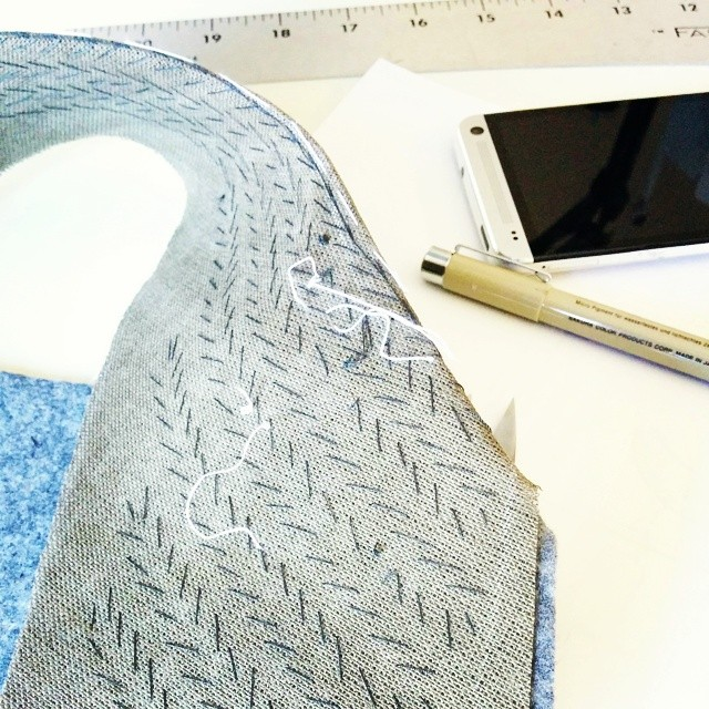 A hand padstitched collar on the bench.