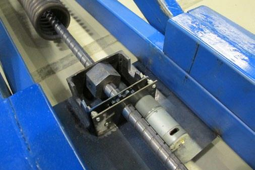 Assembly of the motorised spring adjustment mechanism using the customsteep pitch threaded rod with a keyway and gear box.