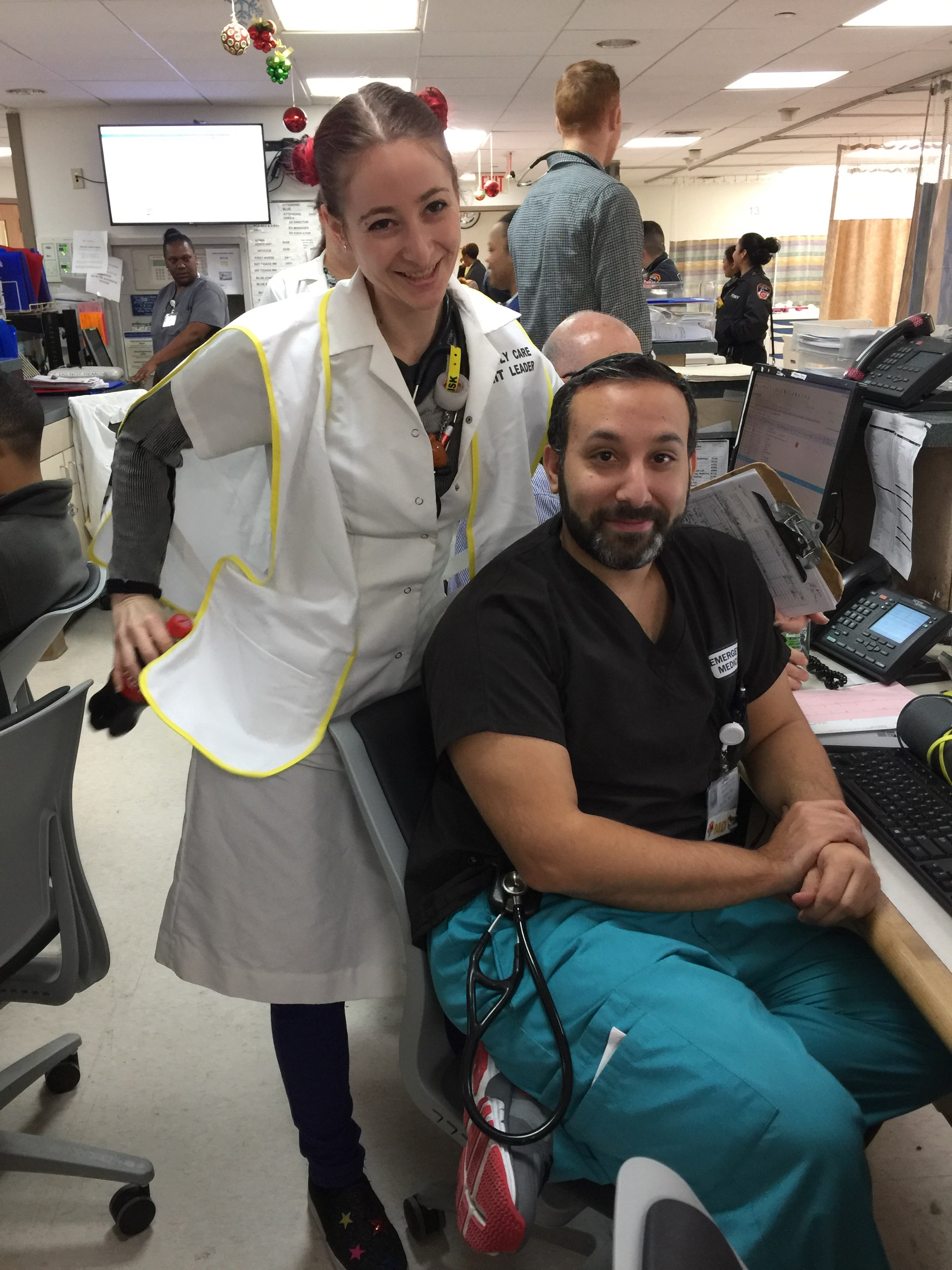 Dr. Ambert forcing a smile onto Dr. Butel's usually stolid mien (both of those words can be your Word-of-the-Day)