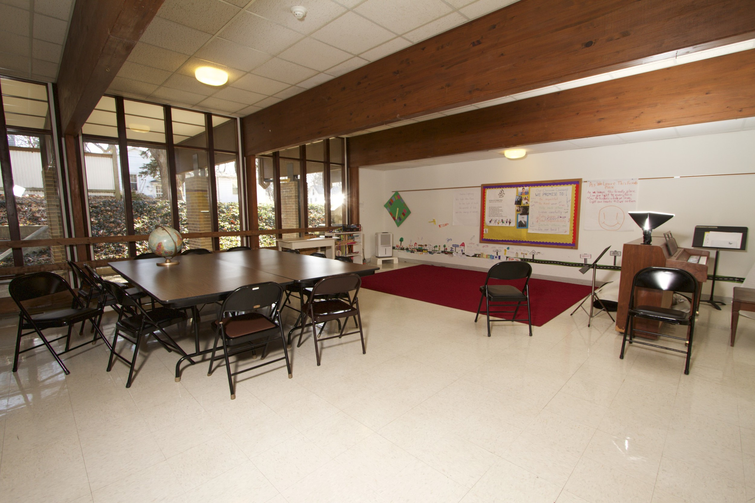 This is a view of Classroom 1 looking southwest from near the room entrance with windows to the south.