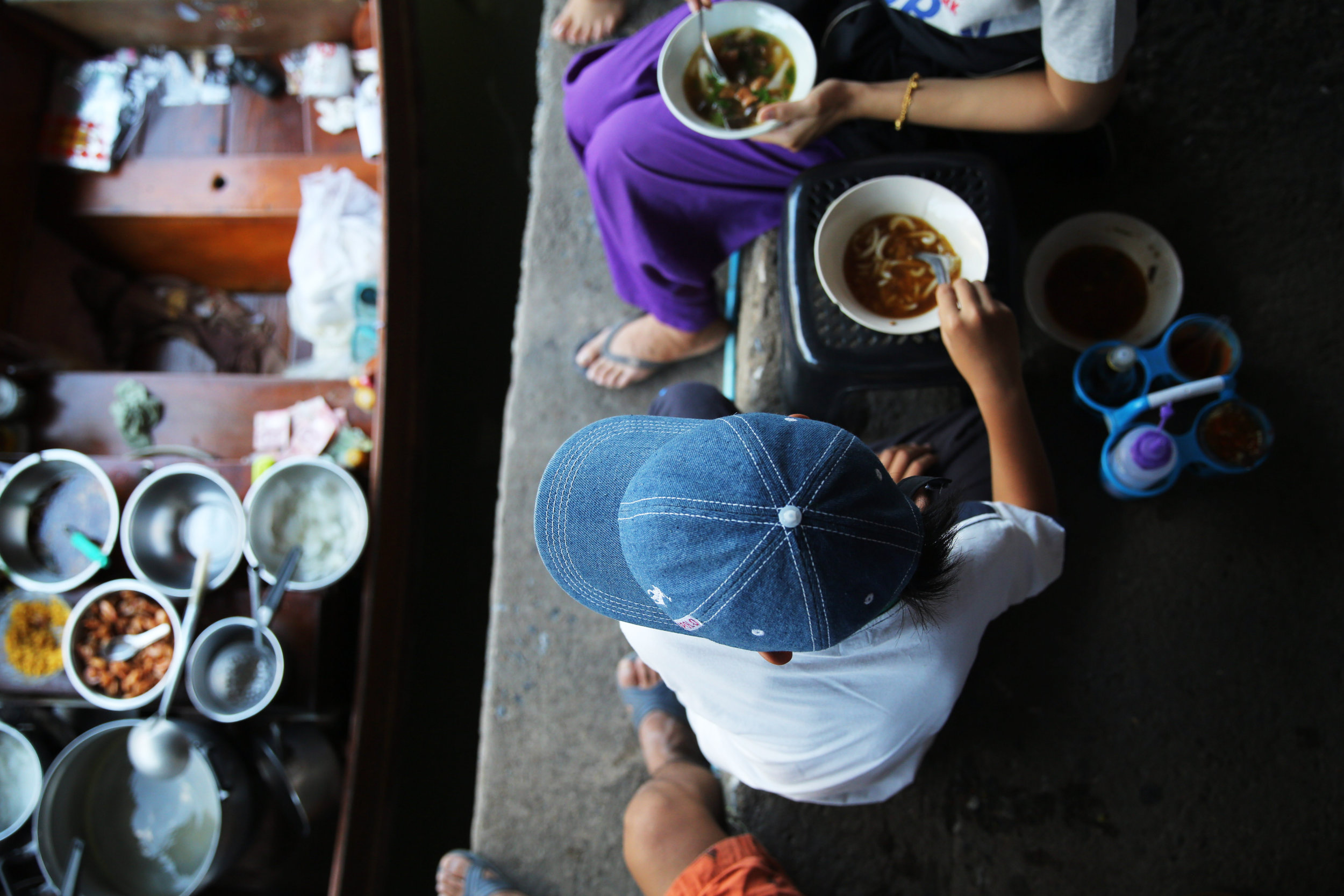 damnoen-saduak-floating-market-boy-soup-gaze.jpg