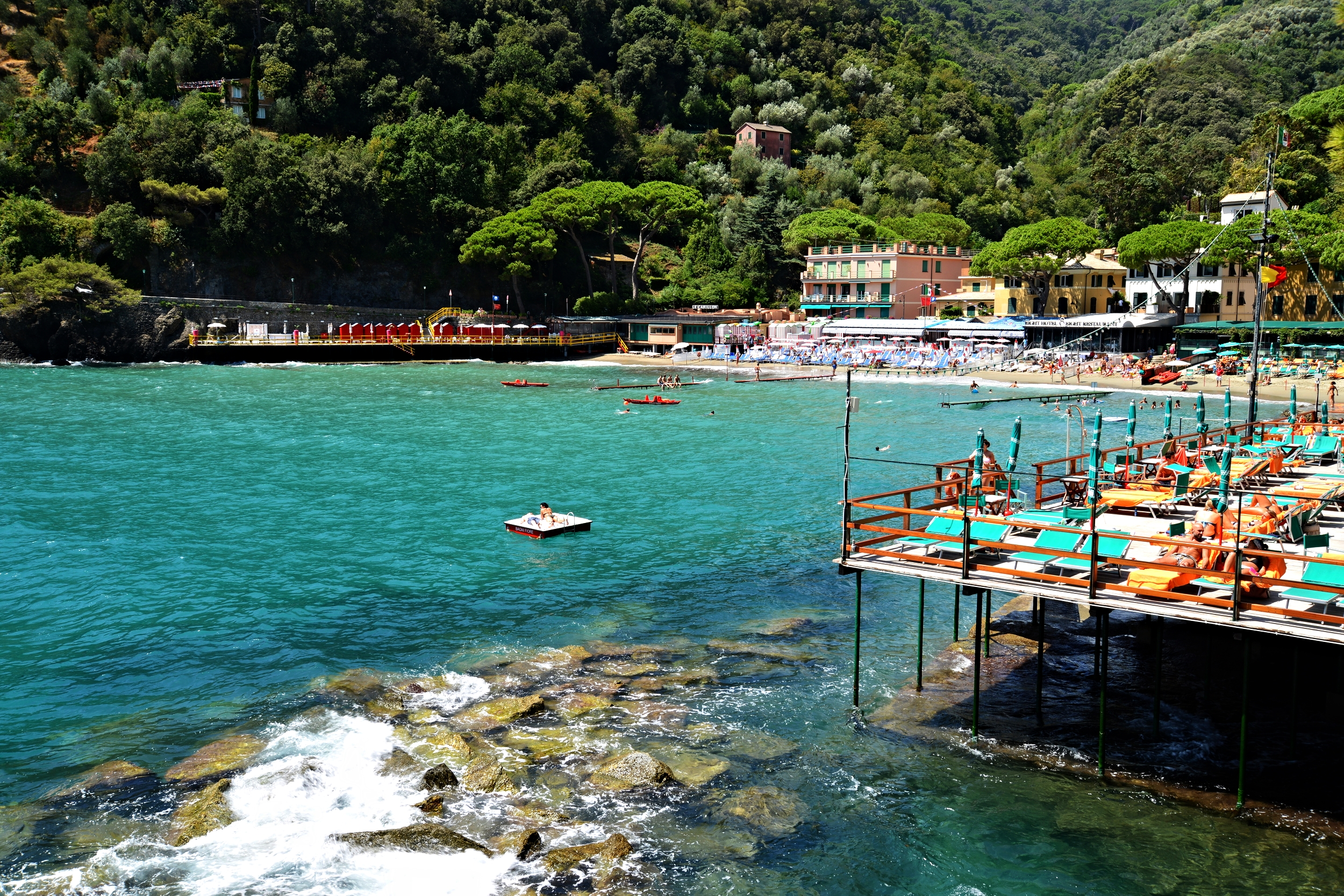 The bright turquoise warm water of the Liguria Coast in Italy is so inviting, you can't resist to jump in!