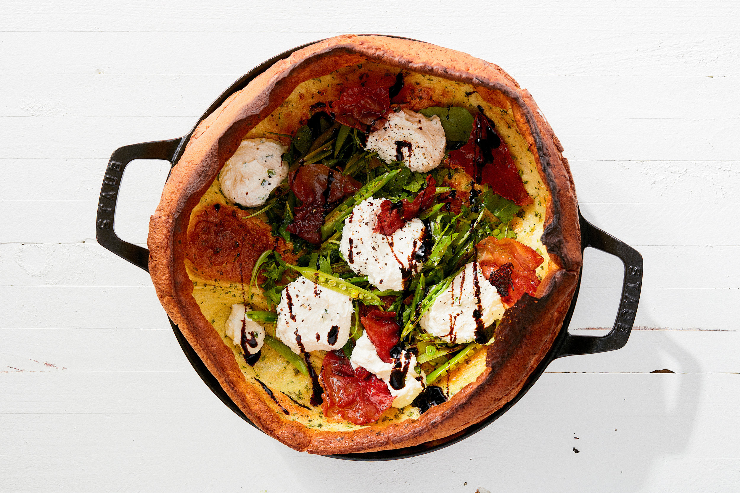 kB6iXExrQdaS4oHzn0oC_Savory_Dutch_Baby_with_Crispy_Prosciutto__Ricotta__and_Snap_Peas-0023__THUMB.jpg