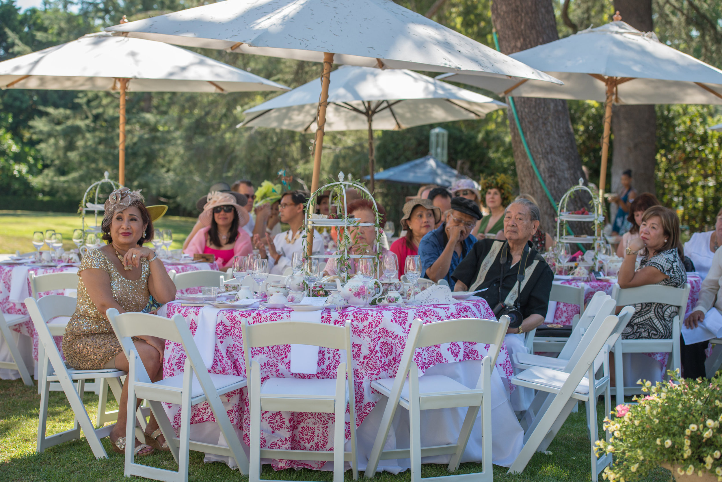 Ramona Haar watches fashion show with tea party attendees