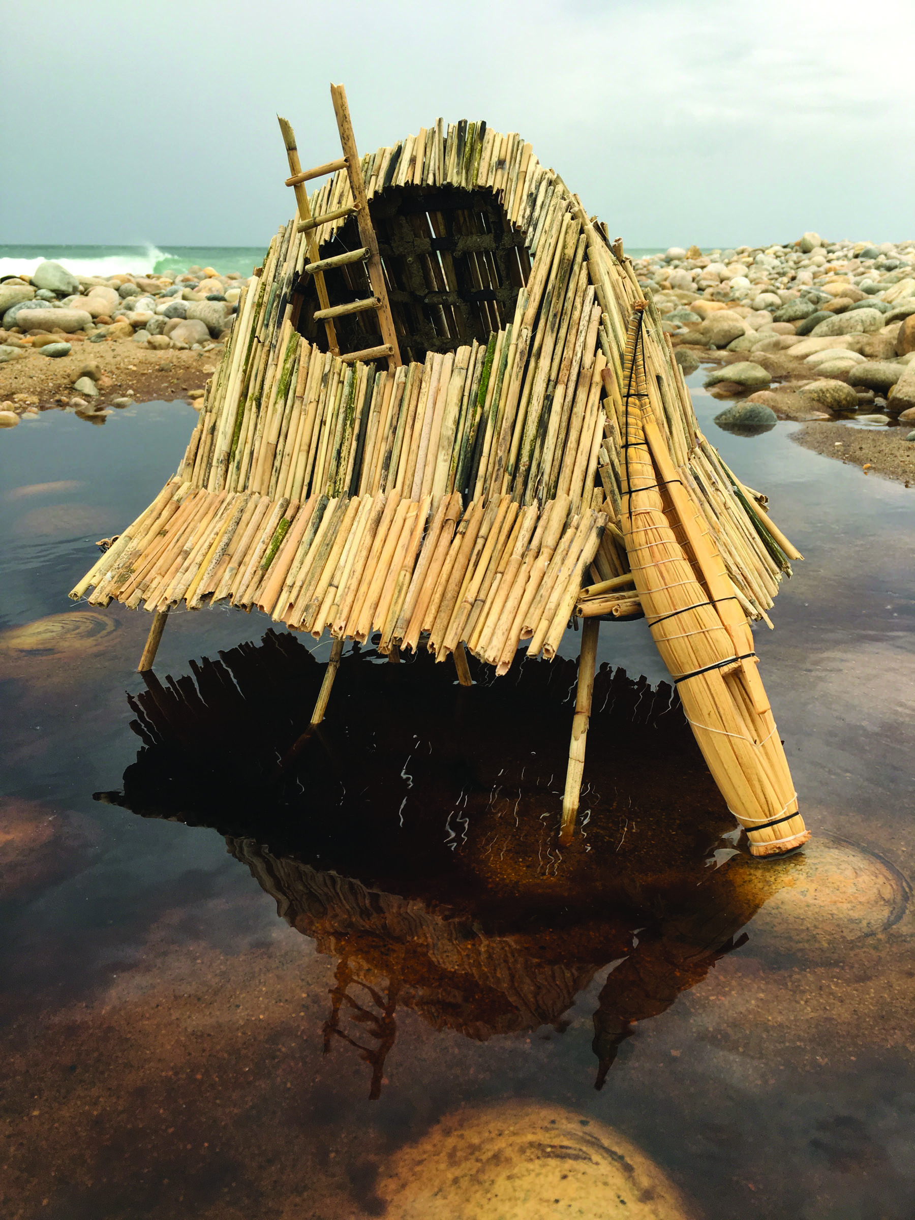 "Stilt House    phragmite reeds, lobster trap, miniature Peruvian reed boat model  14"" x 20"" x 10""  on location at Amsterdam Beach, Montauk, NY. June 2016  (Available as archival digital print, 16"" x 20"", edition of 50)"